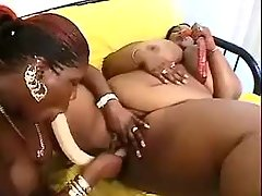 Big busty ebonies play with dildoes