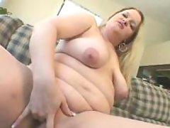 Pretty blond fatty caresses herself