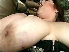 Giant woman in stockings sucks cock