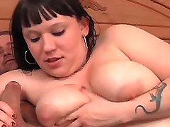 Chubby busty brunette sucking dick