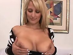 Blonde mature presents her big tits