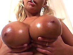 Breasty blonde babe sucks huge cock