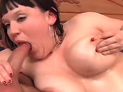 Chubby brunette with big tits sucks