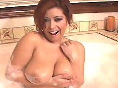 Busty plumper plays w boobs in bath