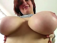 Busty redhead shows her huge boobs