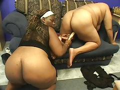 Black bbws fuck each other with a dildo