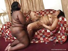 Huge black lesbians masturbate each other
